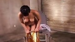 asian in gold jump suit take a vibrator to her cunt