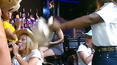 Stripper with a bear head has his phallus ravaged by customers