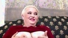 chubby full-grown woman sucks a stiff wand