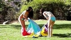 young lesbians play in a slip and slide