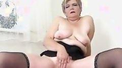 adult masturbates with ebon sex-toy
