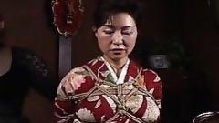 tied geisha awaits her punishment
